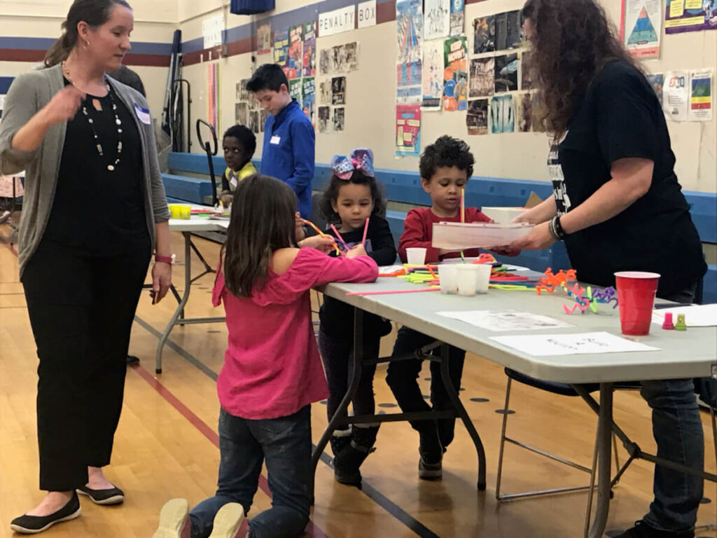 Students make pipe cleaner neurons during Family STEAM Night organized by Abram Lansing Parents Teacher Organization in Cohoes, New York.