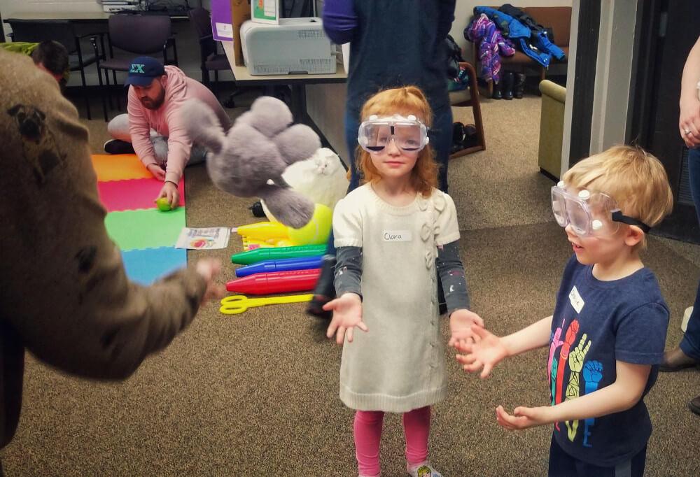 Children test out some perceptual shift goggles at an event organized by the Children's Museum of Southern Minnesota, Mankato in the United States.