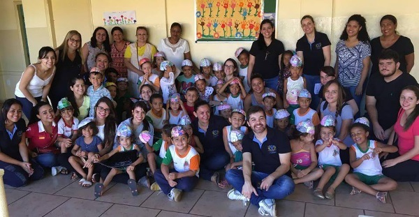 Children wear brain caps during a school visit where 18 psychology students taught them about the brain, organized by Faculdade Barretos in Brazil