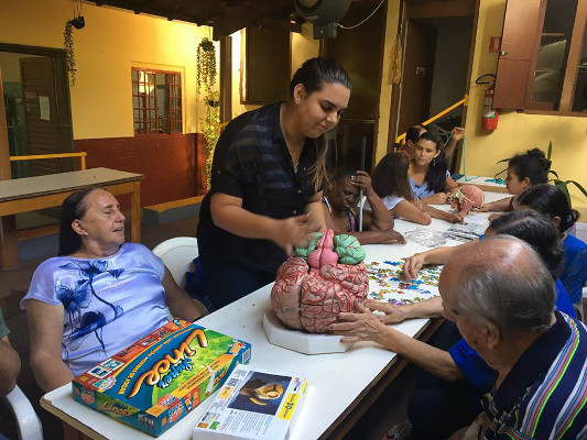 Psychology students perform some activities with people from a local care-giving institution organized by Faculdade Barretos in Brazil