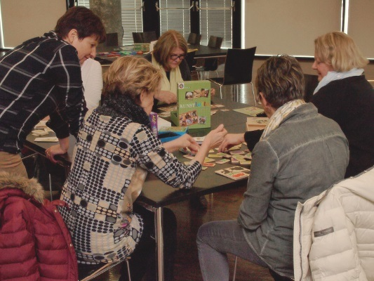 Participants play a brain game that utilizes memory during an event organized by Gedächtnistrainingsakademie in Austria