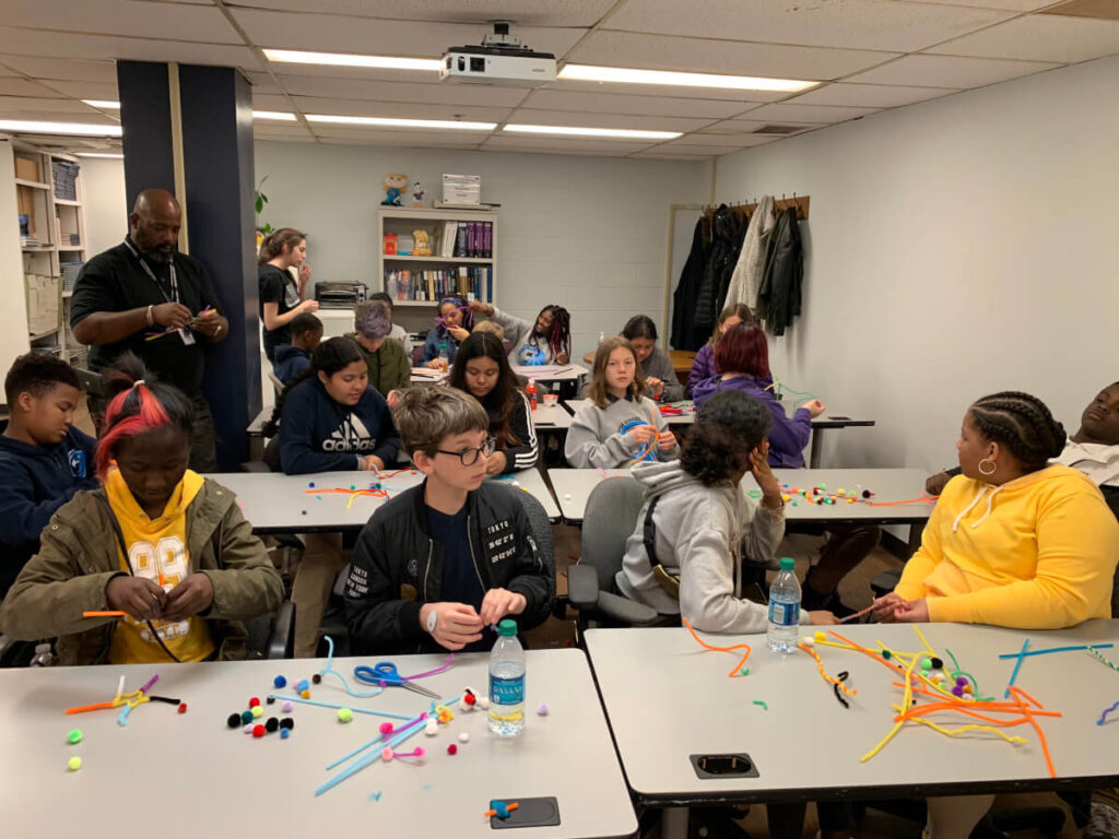 Children make pipe cleaner neurons at an event organized by  Georgetown University in Washington, DC.