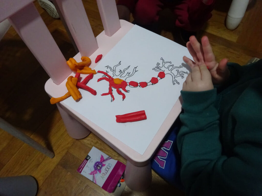 Creating a neuron at an event organized by Hellenic SOS Villages in Heraklion, Greece.