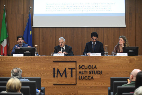 The panel of speakers at a talk organized by IMT School for Advanced Studies in Lucca, Italy