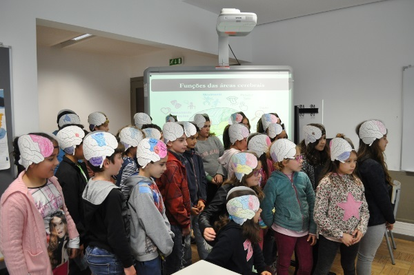 Children attend a brain workshop and wear brain caps, organized by Instituto de Educação e Cidadania (Institute for Education and Citizenship) in Portugal