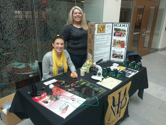 Information table at an event organized by Miami University: Nu Rho Psi in Oxford, Ohio