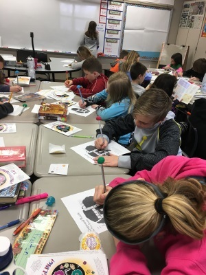 Students complete brain puzzles at Bright Elementary School organized by PCF Consulting in Indiana