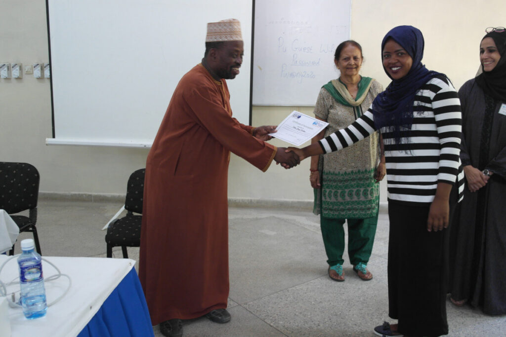 A participant receives a certificate as part of an event organized by the Ubongo Brain Awareness Campaign in Africa.