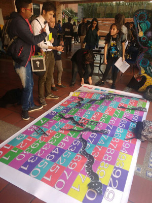 Participants learn about the brain by playing a game during an event organized by Universidad Sergio Arboleda in Bogota, Colombia