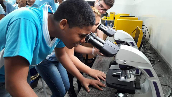 Students visualize brain cells on microscopes during an event organized by Universidade Federal do Sul e Sudeste do Pará in Brazil