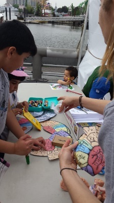 Children learn about parts of the brain while coloring during an event organized by University of Delaware
