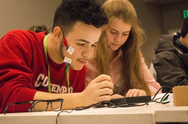 Students participate in an electromyograms experiment during the Alaska Brain Bee organized by University of Alaska Anchorage