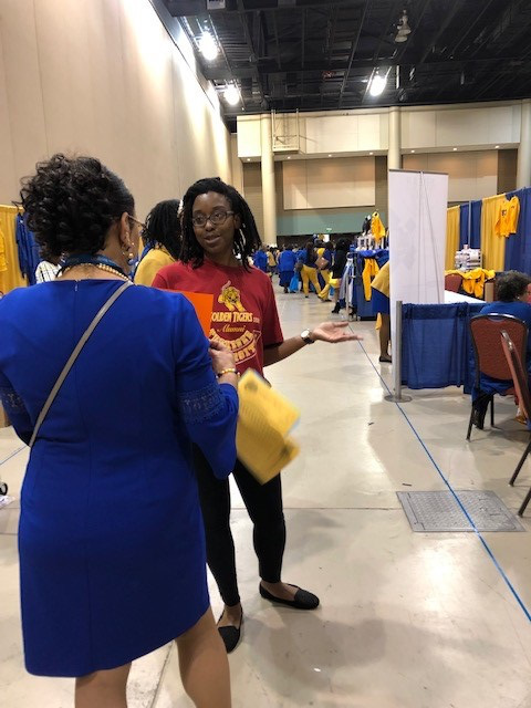 Handing out health information with BAW puzzles on back at an event organized by the Black Nurses Association in Alabama.