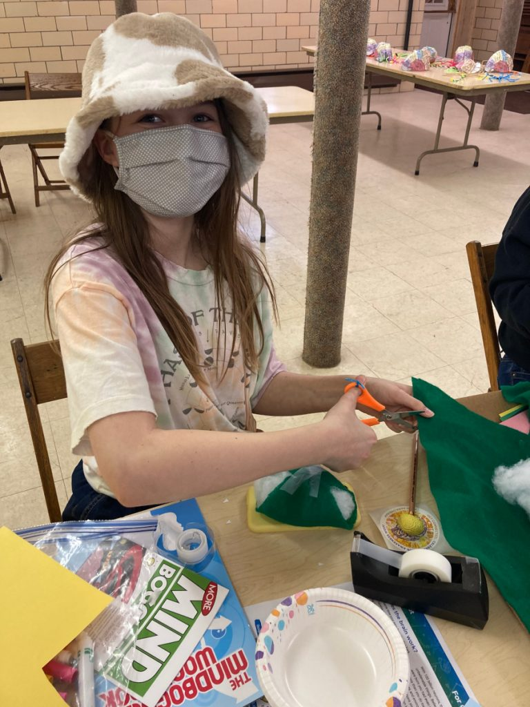 A student participates in an activity on Bike Helmets for Safe Brains (following the Protect a Brain lesson plan) organized by Slippery Rock University in Pennsylvania.