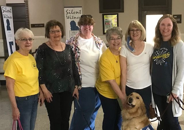 """Proclamation signing with Pilot Club members gathered with a """"Star"""" Facility (autism) service dog organized by the Pilot Club of Great Bend in Kansas.."""