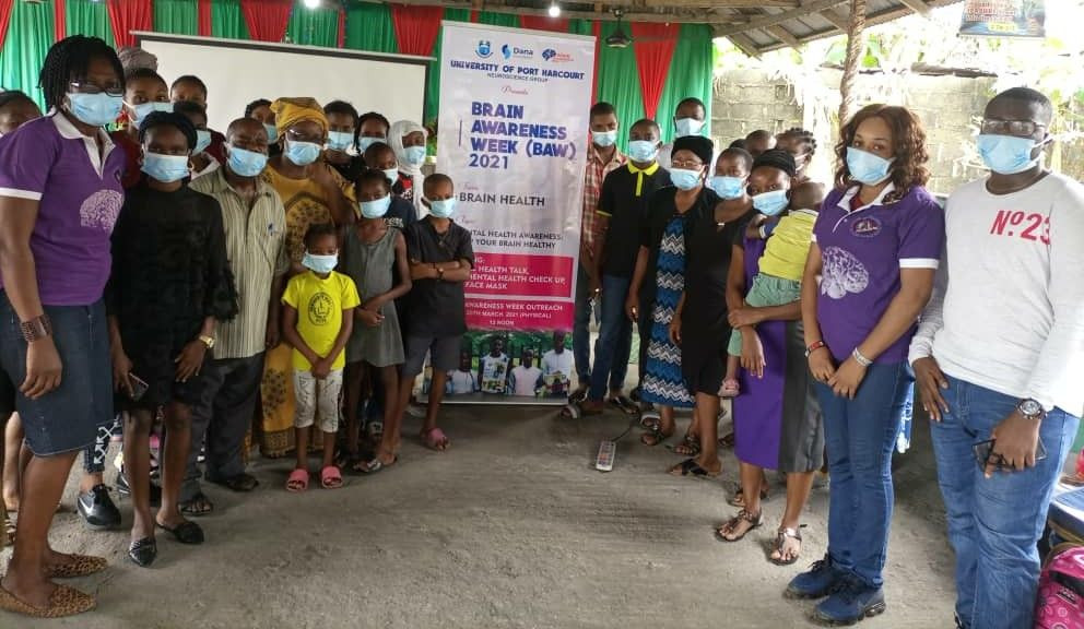 A group poses at an event on mental health awareness organized by the University of Portharcourt in Nigeria.